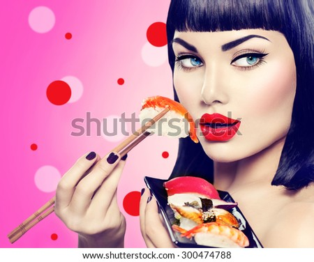 Beauty Fashion model girl eating Nigiri Sushi with chopsticks. Beautiful sexy woman with perfect make up and bob haircut eating healthy japanese food. Diet, dieting concept.  - stock photo
