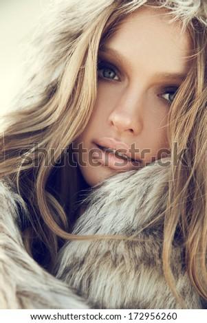 Beauty Fashion Model Girl in a Fur Hat. Winter Woman Portrait. - stock photo