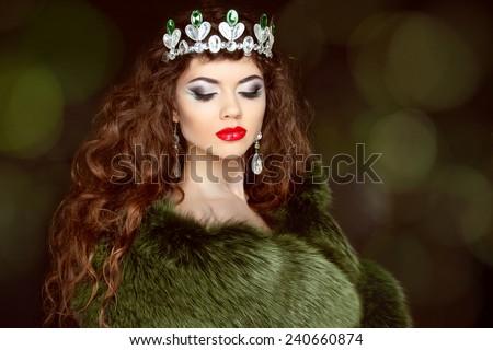 Beauty Fashion Model Girl in Fur Coat. Diamond jewelry. Beautiful Luxury Winter Woman. - stock photo