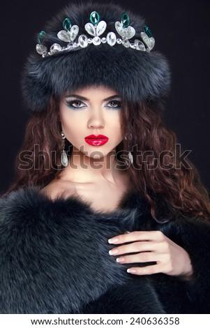 Beauty Fashion Model Girl in Fur Coat. Diamond jewelry. Beautiful Luxury Winter Woman in royal crown.  - stock photo