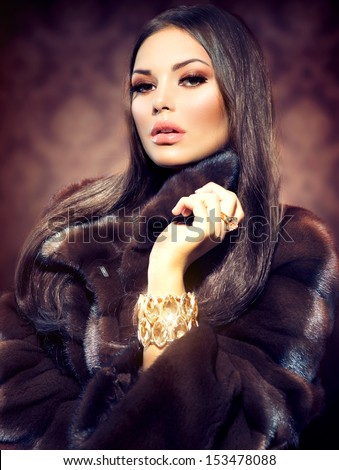 Beauty Fashion Model Girl in Mink Fur Coat. Beautiful Woman in Luxury Brown Fur Jacket  - stock photo