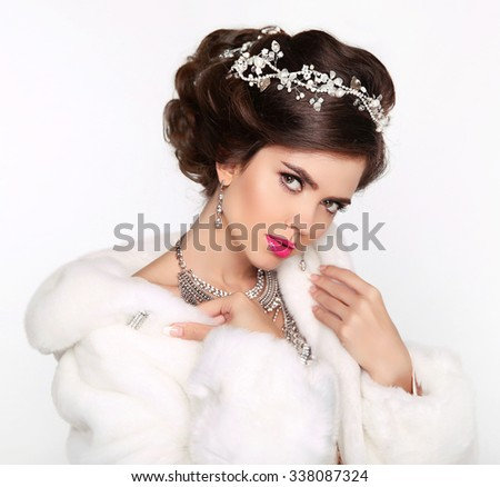Beauty Fashion Model Girl in white Mink Fur Coat. Beautiful Luxury Winter Woman isolated on white background. - stock photo