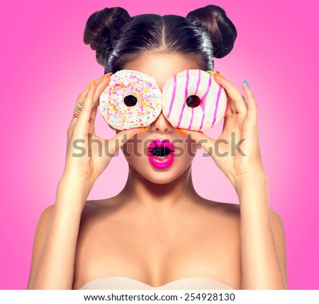 Beauty fashion model girl taking colorful donuts. Funny joyful woman with sweets, dessert. Diet, dieting concept. Junk food, Slimming, weight loss