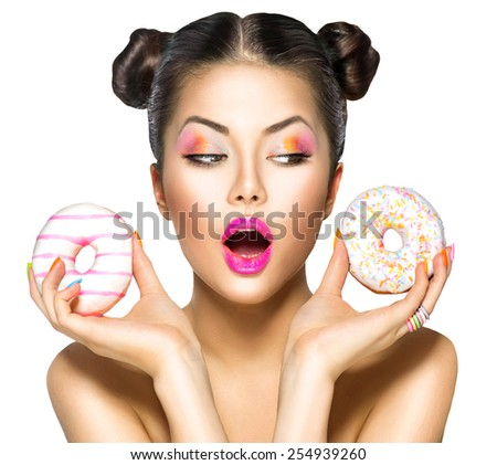 Beauty fashion model girl taking colorful donuts. Funny joyful woman with sweets, dessert. Diet, dieting concept. Junk food, Slimming, weight loss. Isolated on white background - stock photo