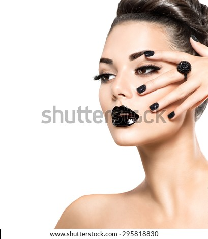 Beauty Fashion Model Girl with Black Make up, Long Lushes. Fashion Trendy Caviar Black Manicure. Nail Art. Dark Lipstick and Nail Polish. Isolated on white background - stock photo