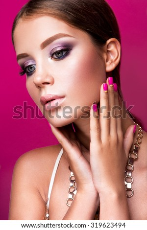 Beauty fashion model girl with bright makeup, long hair, manicured nails. Glamour woman isolated on pink studio background. - stock photo
