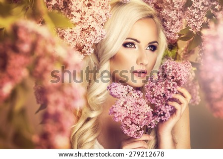 Beauty fashion model girl with lilac flowers  - stock photo