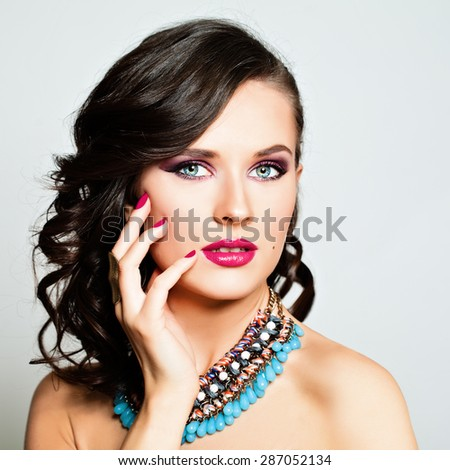 Beauty Fashion Portrait. Beautiful Woman with Makeup and Hairstyle. Curly Hair, Sexy Pink Lips, Colorful Nails, Eye Shadow - stock photo