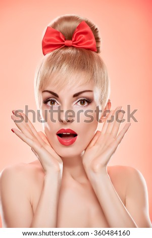 Beauty fashion portrait happy woman surprised looks. Sensual attractive pretty nude blonde sexy girl, Pinup hairstyle, red bow. Unusual emotional playful. Romantic, retro vintage, skincare on pink - stock photo