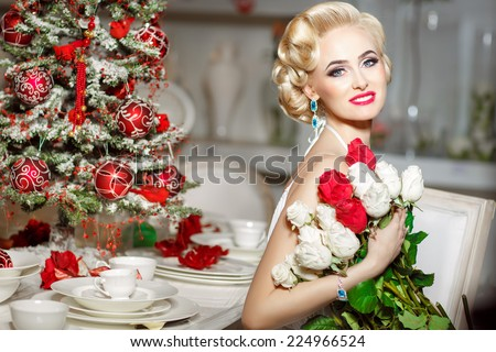 Beauty fashion woman at Christmas dinner, new year tree background. Vogue style sexy girl. Gorgeous girl in luxury Xmas party. Luxury life concept. Retro style girl. makeup fashion jewelry model - stock photo