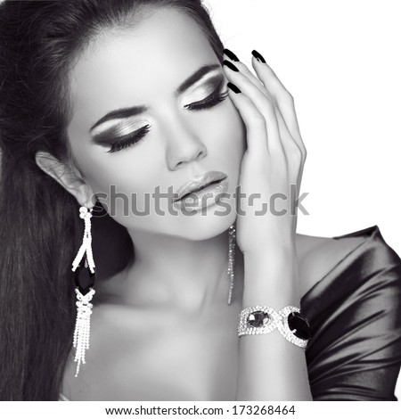 Beauty Fashion Woman Portrait. Jewelry accessories. Black and white studio photo