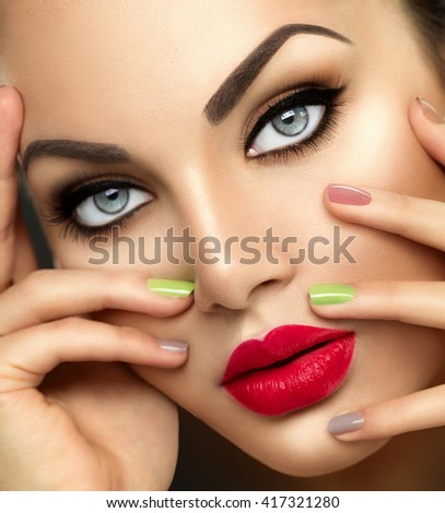 Beauty Fashion woman Portrait with Vivid Makeup and colorful Nail polish. Colourful nails. Beauty girl portrait close up. Bright Colors. Red lips, Manicure, Bright Make up. Smoky eyes, long eyelashes