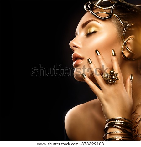Beauty Fashion woman with Golden Makeup, accessories and nails. Girl Portrait with gold earrings, rings, bracelets and manicure closeup isolated on black background. Fashion art Hairstyle and make up - stock photo