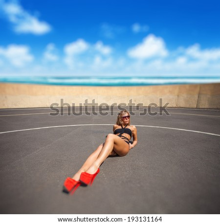 Beauty fashion woman with perfect body and legs in red shoes - stock photo