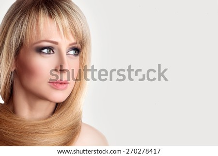 Beauty Female Face. Long Blonde Hair around Neck, Fresh Clear Skin, Nude Make up. Beautiful Woman.