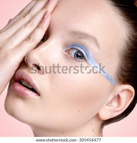 Beauty female model pink  background. Futuristic fashion make up