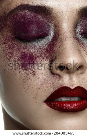 Beauty female Model with purple Makeup and red Lips