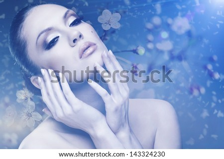 Beauty. Female outdoors portrait with floral backgrounds - stock photo
