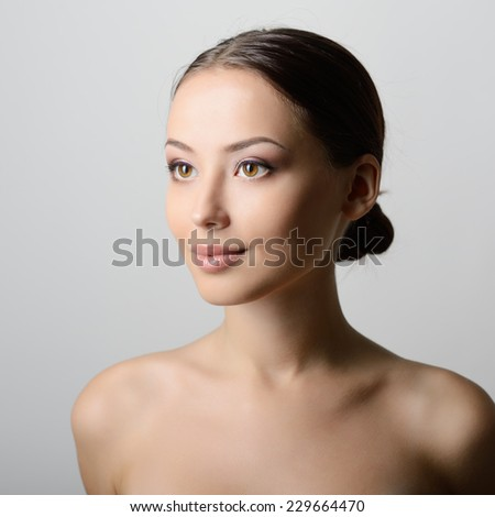Beauty female portrait. Young beautiful woman with clean skin. Face and shoulders. - stock photo