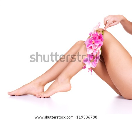 Beauty female slim legs after spa therapy isolated on white - stock photo