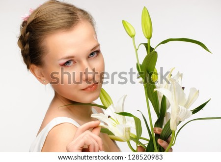beauty flower girl on the white background with lily