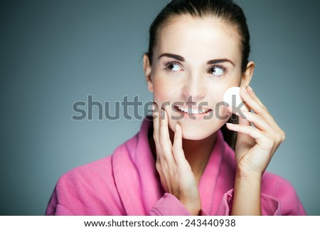 Beauty fresh girl cleaning face with cotton swab - stock photo