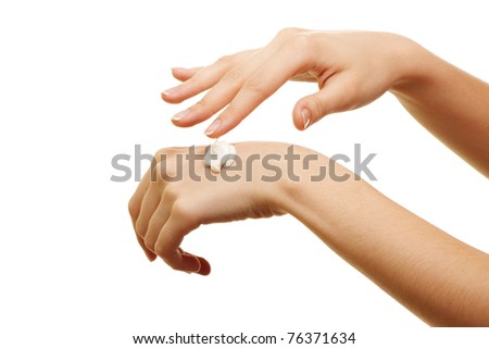 beauty girl applying some white lotion on her hand - stock photo