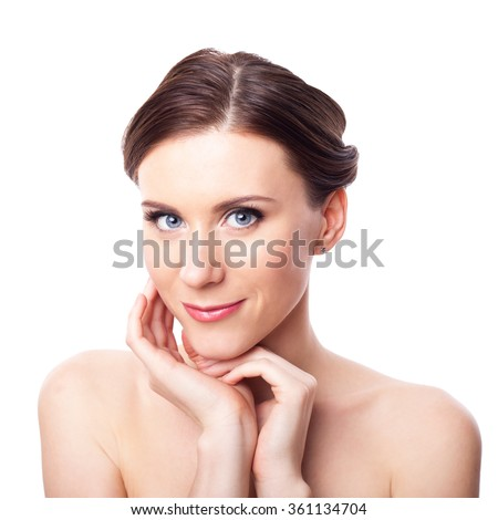 Beauty Girl. Beautiful woman cares for the skin neck. Portrait isolated on white background. Fresh Clean Skin.
