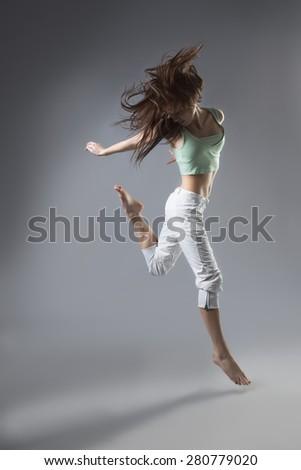 beauty girl dance on grey background - stock photo