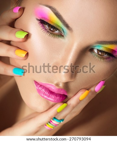 Beauty Girl face with Vivid Makeup and colorful Nail polish. Colourful nails. Fashion Woman portrait close up. Bright Colors. Long eyelashes, vivid eyeshadows Rainbow make up - stock photo