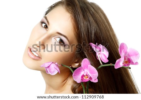 beauty girl, happy young natural beautiful woman over white background with long brown hair and purple orchid, over white background - stock photo