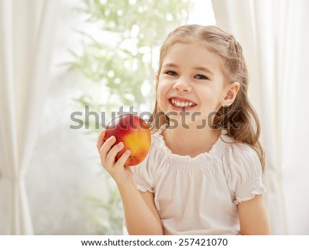beauty girl holding red apple - stock photo