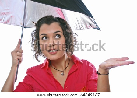 beauty girl looks out from under an umbrella on white background - stock photo