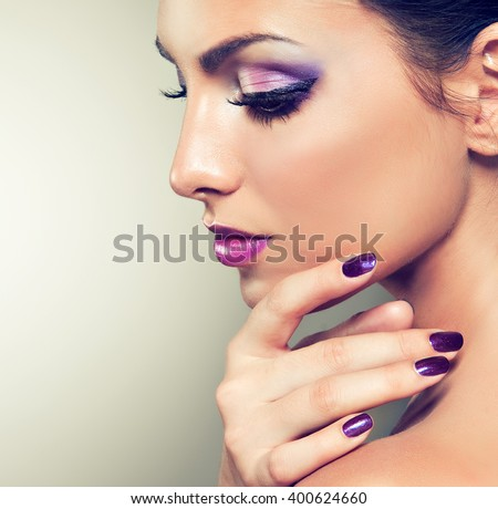 Beauty girl model with violet manicure  on the nails.  Cosmetics and cosmetology . - stock photo
