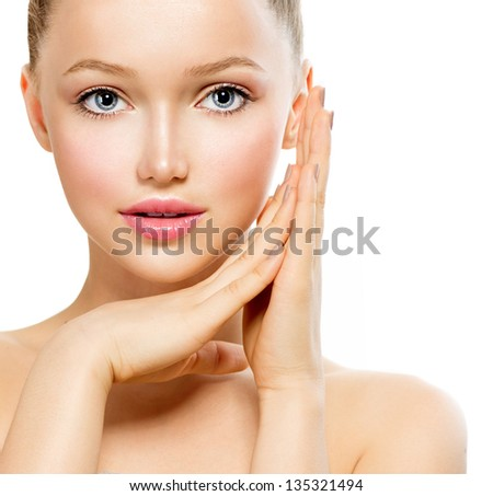 Beauty Girl Portrait. Beautiful Model Woman Face. Looking at Camera. Isolated on White Background. Pretty Girl Touching her Face - stock photo