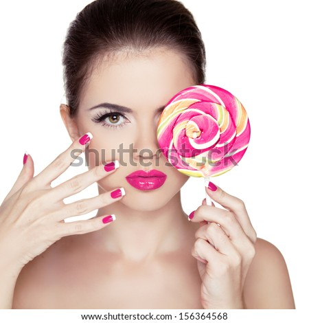 Beauty Girl Portrait holding Colorful lollipop. Fashion makeup. Nail polish manicured nails. Skin care. Isolated on white background. Colourful Studio Shot of Funny Woman. - stock photo