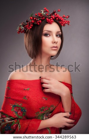 Beauty Girl. Portrait of Beautiful Young Woman with a wreath on his head. Fashion portrait.