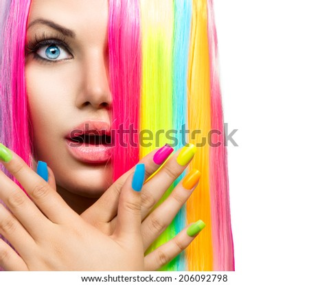 Beauty Girl Portrait with Colorful Makeup, Hair and Nail polish. Colourful Studio Shot of Surprised Woman face closeup. Vivid Colors. Manicure and Hairstyle. Rainbow Colors manicure - stock photo