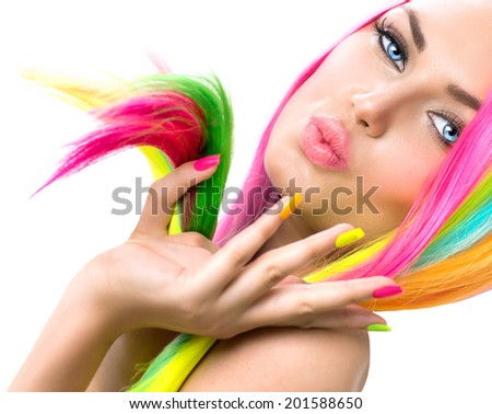 Beauty Girl Portrait with Colorful Makeup, Hair and Nail polish. Colourful Studio Shot of Woman face closeup. Vivid Colors. Manicure and Hairstyle. Rainbow Colors manicure  - stock photo