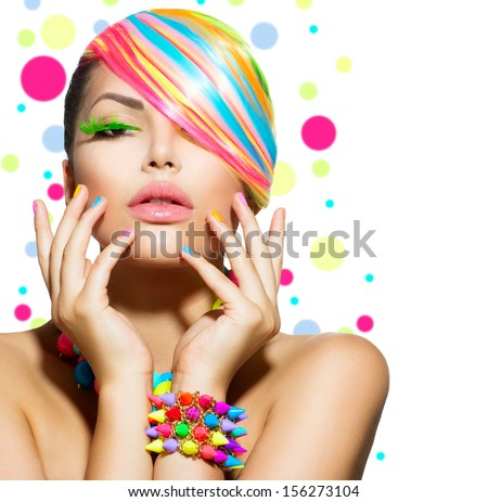 Beauty Girl Portrait with Colorful Makeup, Hair, Nail polish and Accessories. Colourful Studio Shot of Stylish Woman. Vivid Colors. Manicure and Hairstyle. Rainbow Colours  - stock photo
