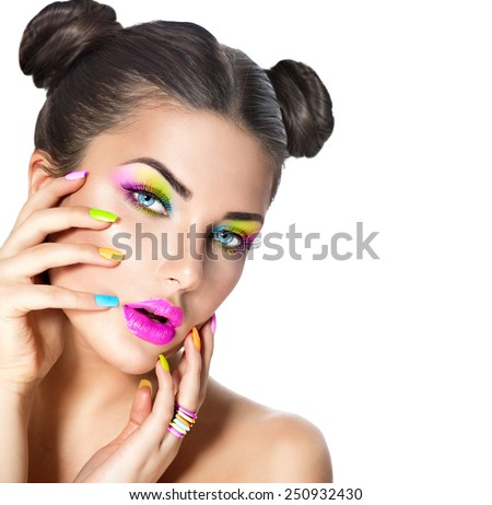 Beauty Girl Portrait with Colorful Makeup, Nail polish and ring Accessories. Colourful eyeshadows make-up. Studio Shot of Stylish Woman. Vivid Colors. Manicure and Hairstyle. Rainbow Colours  - stock photo