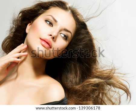 Beauty Girl portrait with long Hair. Beautiful Brunette Woman with Blowing Healthy Hair. Natural Beauty - stock photo