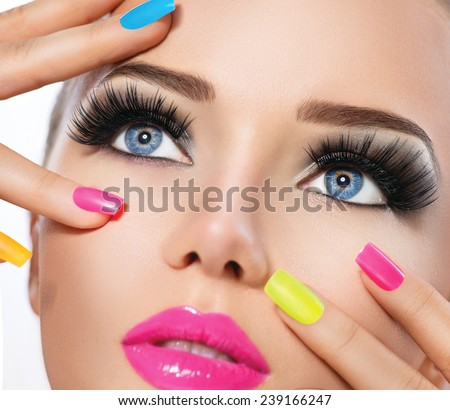Beauty Girl Portrait with Vivid Makeup and colorful Nail polish. Colourful nails. Fashion Woman portrait close up. Bright Colors. Manicure Make up. Smoky eyes, long eyelashes. Rainbow Colors