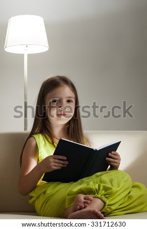 beauty girl read book on sofa - stock photo