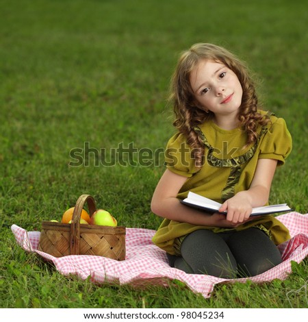 beauty girl  read book outdoors - stock photo