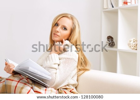 beauty girl reading book in the room - stock photo