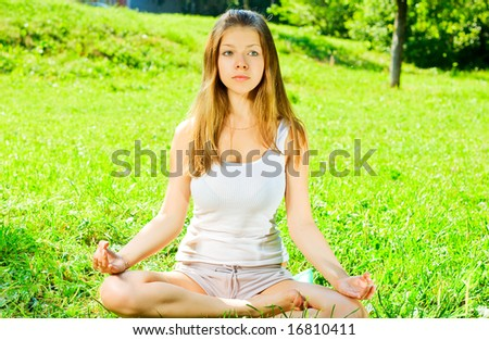 Beauty  girl relaxes on the grass 6
