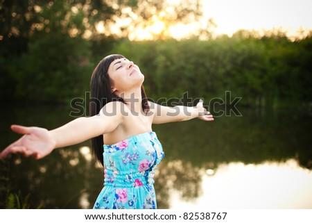 beauty girl. relaxing near lake - stock photo