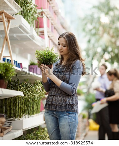 beauty girl shoping green plant - stock photo