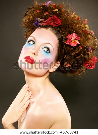 Beauty girl with a bright colored fashion makeup